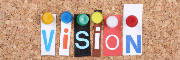 Letters of vision pinned to corkboard